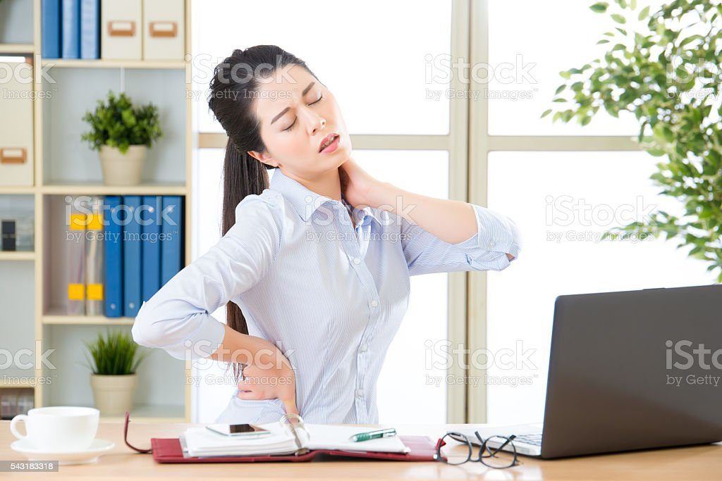 Young asian business woman with pain in neck stock photo