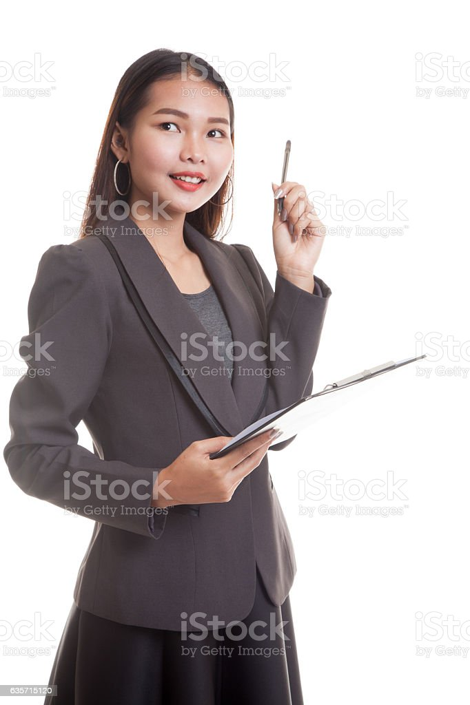 Young Asian business woman with pen and clipboard. royalty-free stock photo
