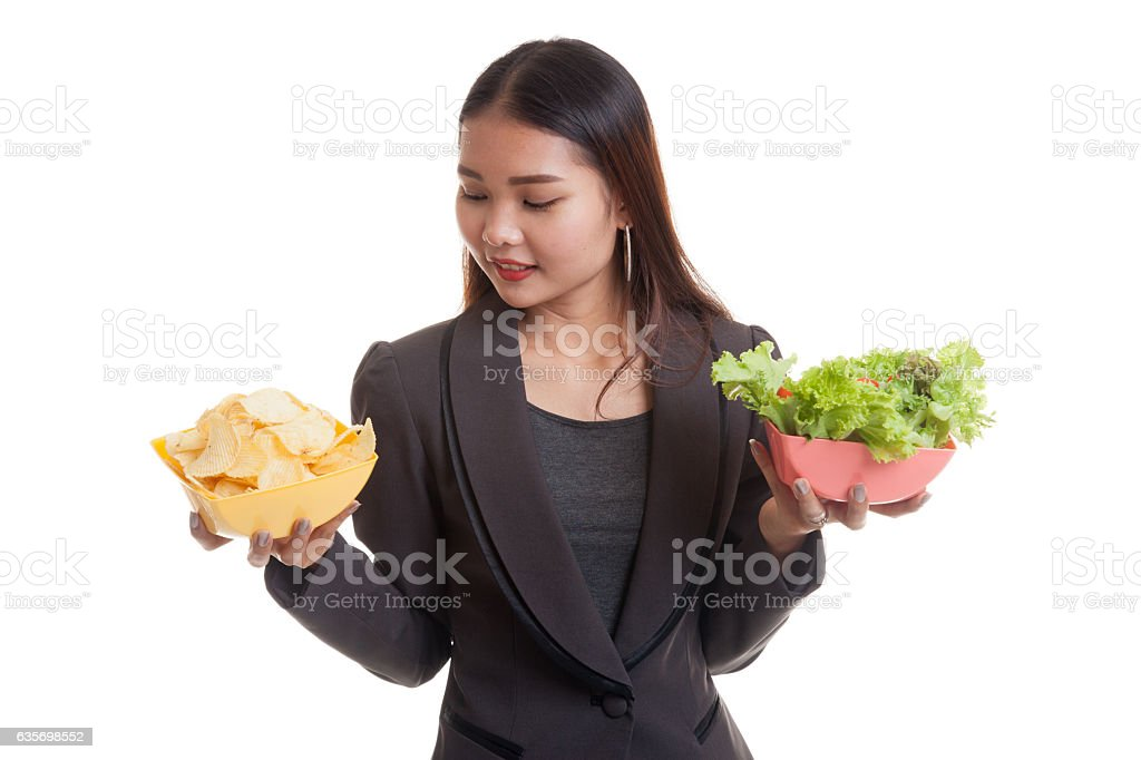 Young Asian business woman with potato chips and salad. royalty-free stock photo