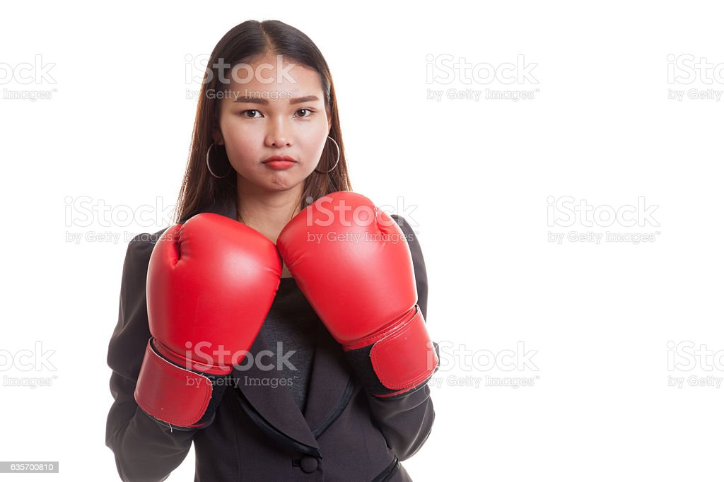 Young Asian business woman with red boxing gloves. royalty-free stock photo