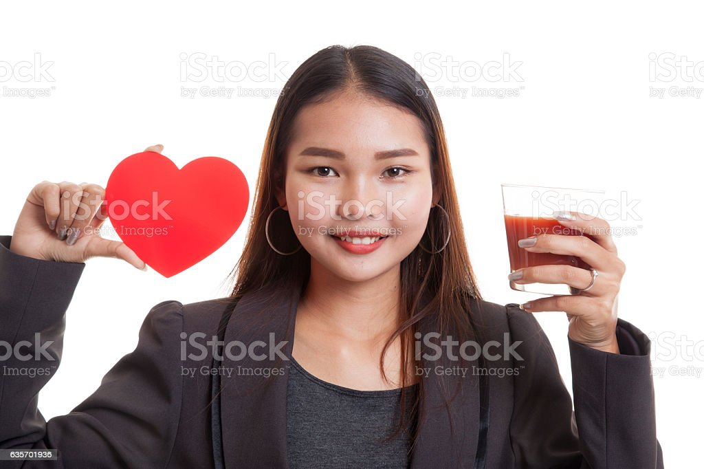 Young Asian business woman with tomato juice and red heart. royalty-free stock photo