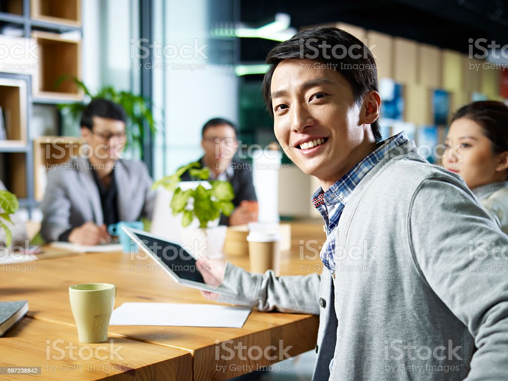 young asian businessman looking at camera stock photo