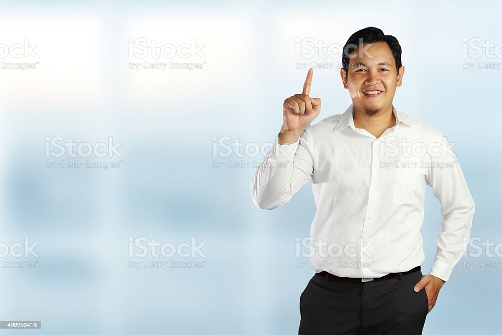 Young Asian Businessman Showing Number One Gesture stock photo