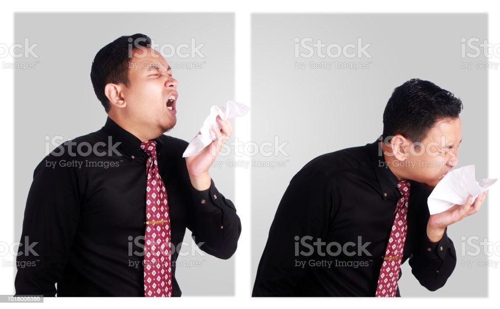 Young Asian Businessman Sneeze stock photo