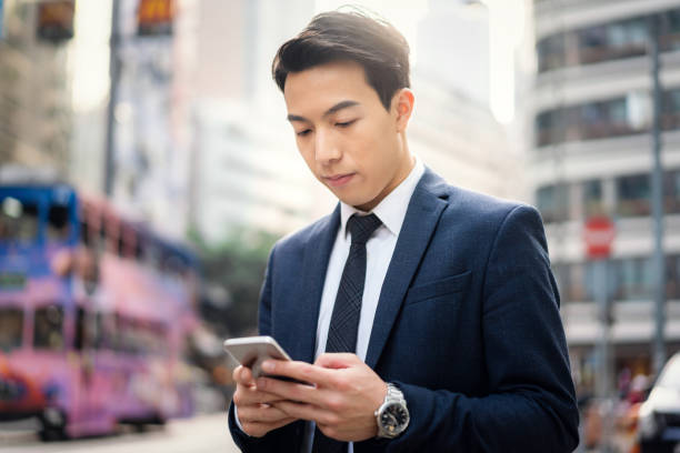 Young Asian businessman using his smartphone stock photo