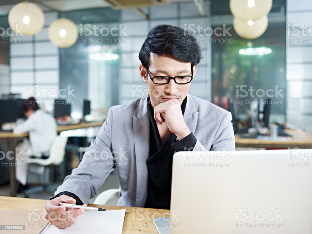 young asian businessman working in office stock photo