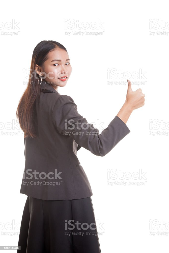 Young Asian businesswoman turn back thumbs up. royalty-free stock photo