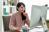 istock Young asian businesswoman using computer work from home for protect virus and take care of their health from COVID-19. Working at home and social distancing concept. 1215019652