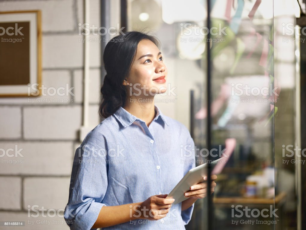 young asian businesswoman working in office stock photo