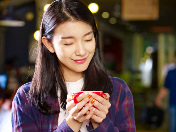 young asian coffee lover stock photo