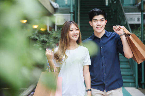 Young Asian Couple going out for shopping Young Asian Couple going out for shopping shopping couple asian stock pictures, royalty-free photos & images