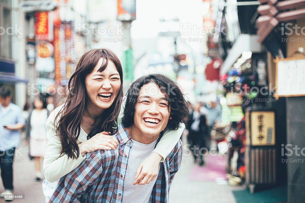 Young asian couple having fun stock photo