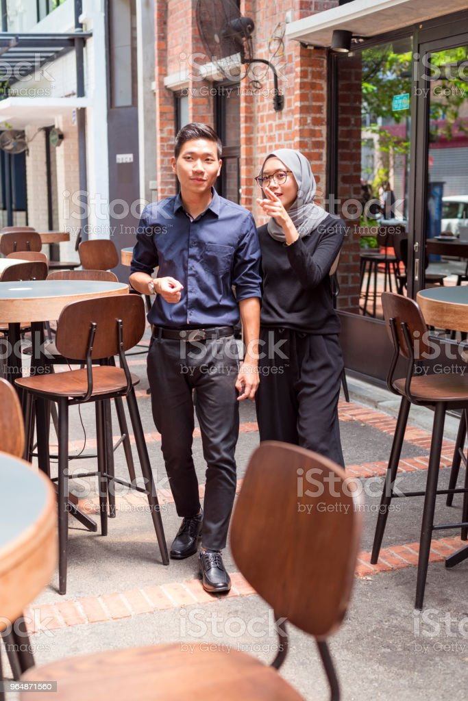Young Asian couple in a coffee shop royalty-free stock photo