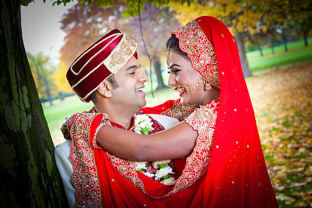 Young Asian couple in traditional dress stock photo