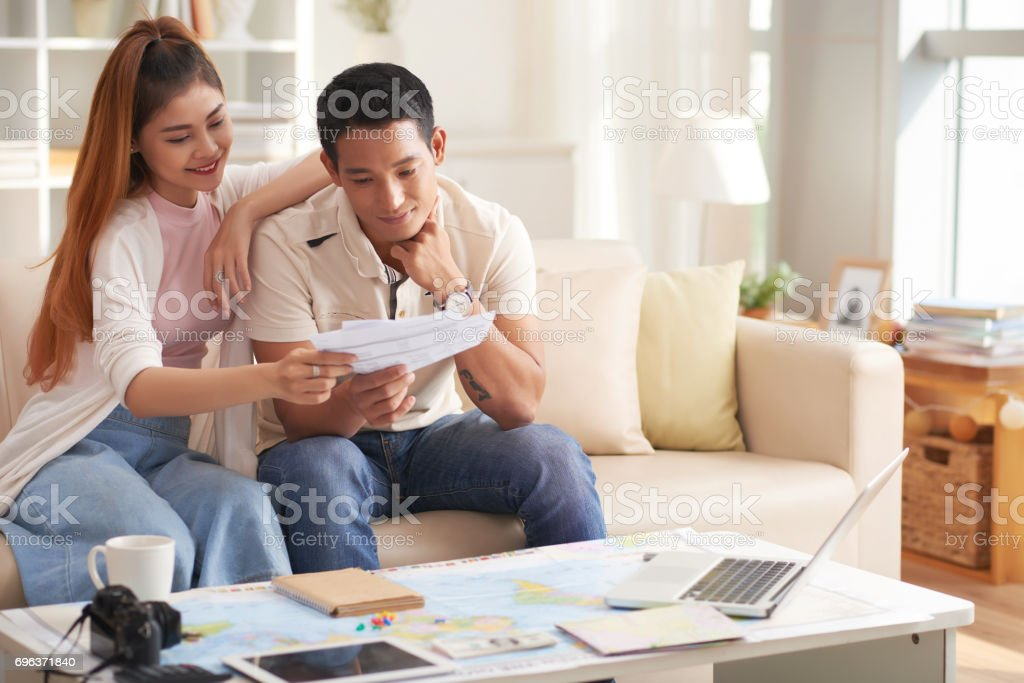 Young Asian Couple Planning Vacation stock photo