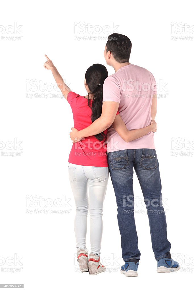 Young asian couple pointing something stock photo