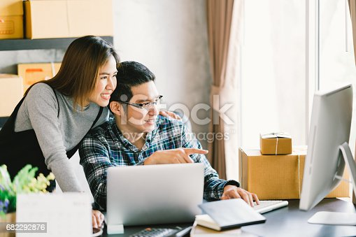 istock Young Asian couple startup family business, online marketing packaging and delivery scene. SME entrepreneur, business partner, or freelance work at home concept 682292876
