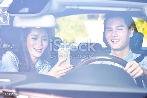 817334706 istock photo young asian couple traveling 817335766