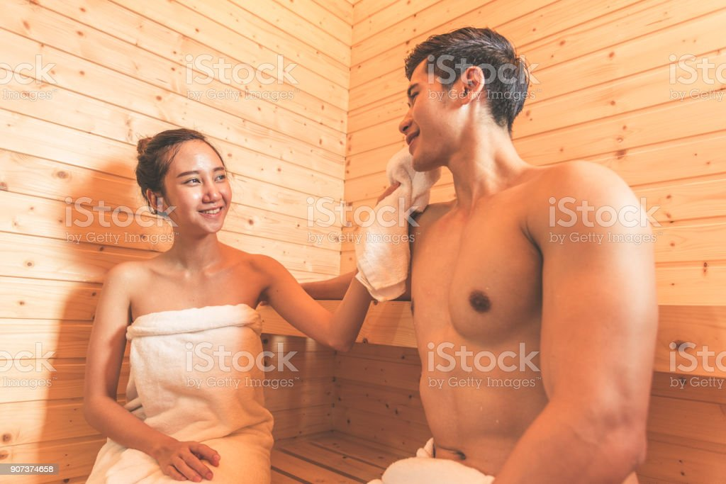 Young Asian Couples Or Lovers Have Romantic Relaxing In Sauna Room Skin Care Heat Treatment