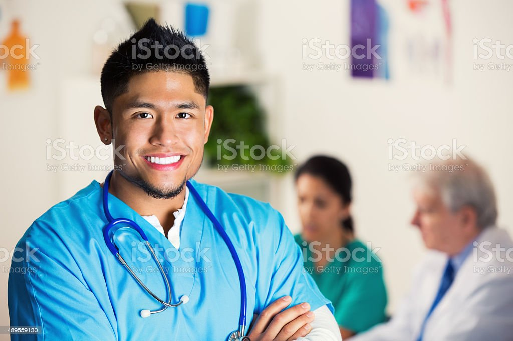 Young Asian doctor is smiling before hospital staff meeting stock photo
