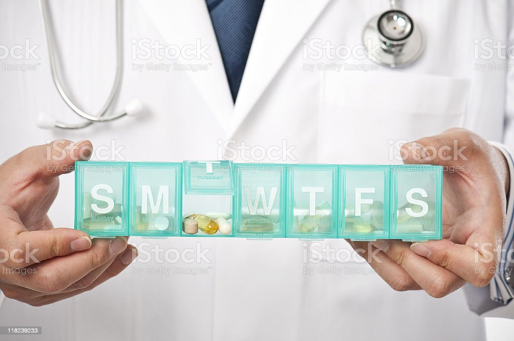 Young asian Doctor With Pill Box stock photo