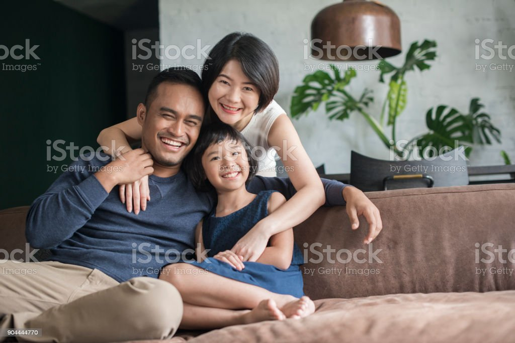 Young Asian family at home. stock photo