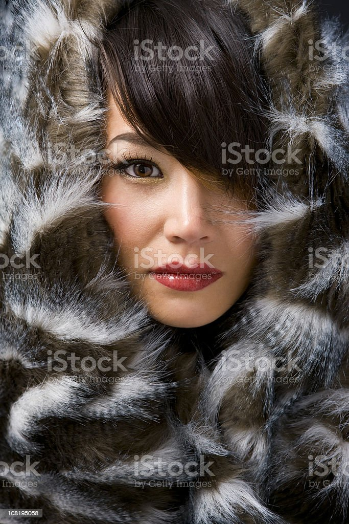 Asian Young Woman in Eskimo Fur Beauty Close Up stock photo