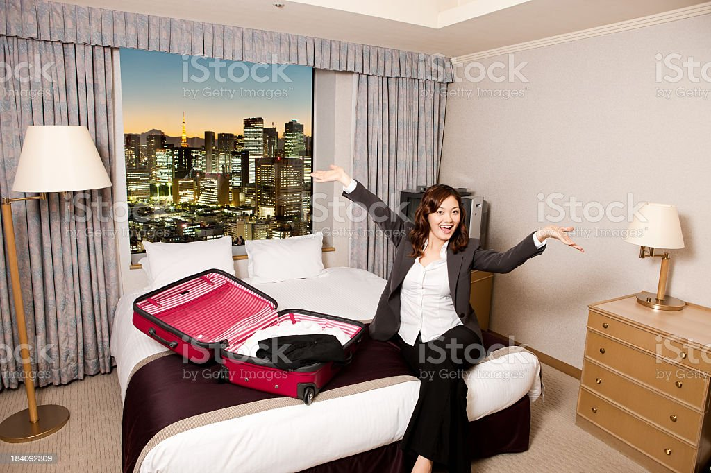 Young Asian Female with Open Suitcase royalty-free stock photo