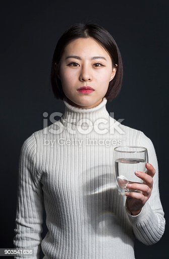 young asian female with purified water,portrait