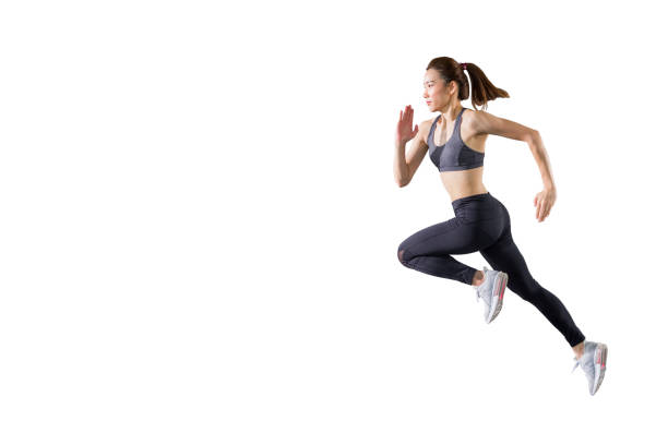 young asian fitness woman in sportwear  running  isolated on white background . excited runner , jumping  girl with copy space stock photo