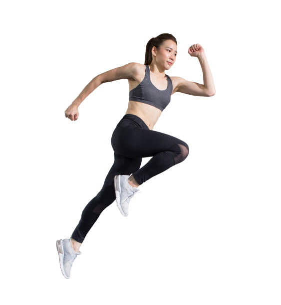young asian fitness woman in sportwear  running  isolated on white background  with clipping path. exercise runner , jumping  girl , workout ,sport ,training stock photo