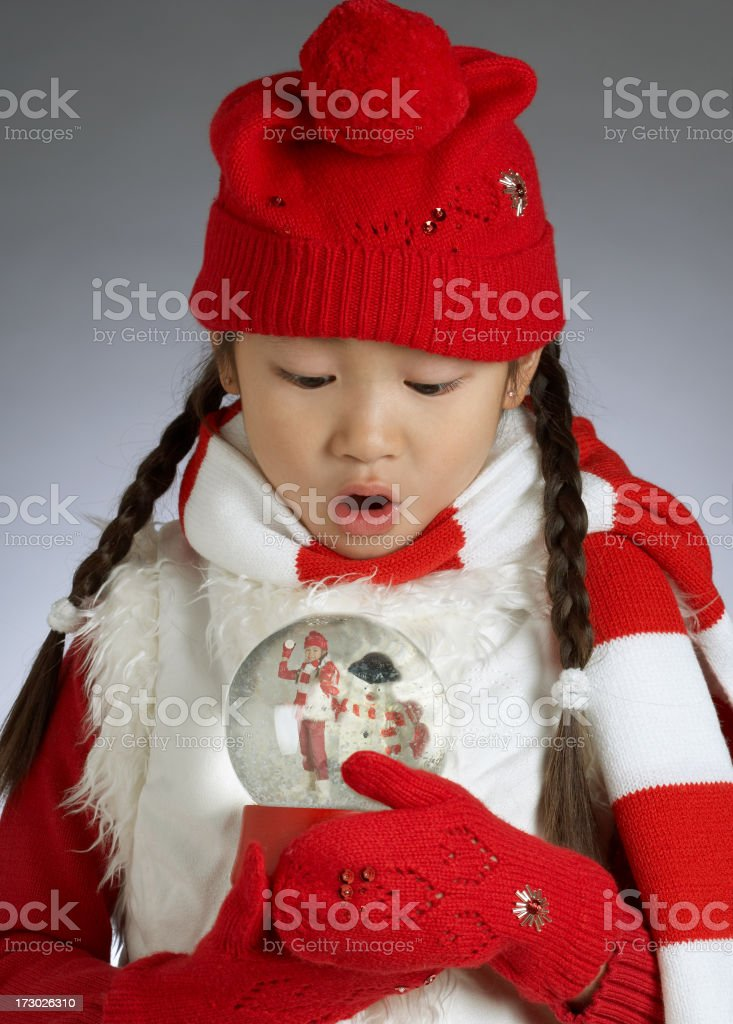 Young Asian girl holding Snow Globe royalty-free stock photo