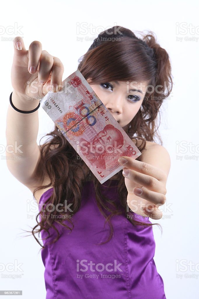 Young Asian girl holding the RMB royalty-free stock photo