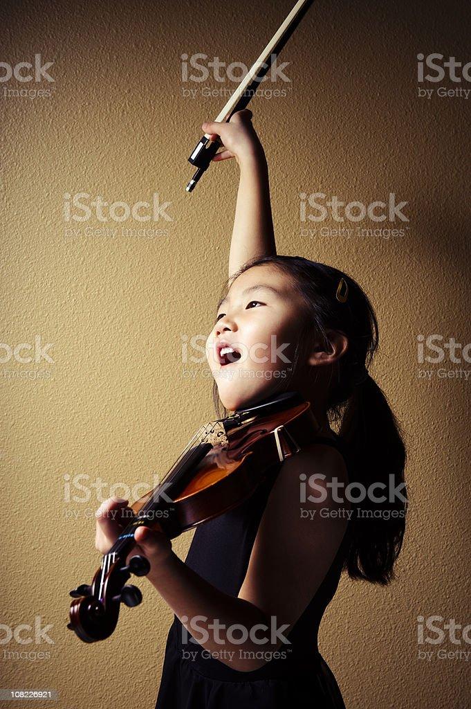 Young Asian Girl Playing Violin royalty-free stock photo