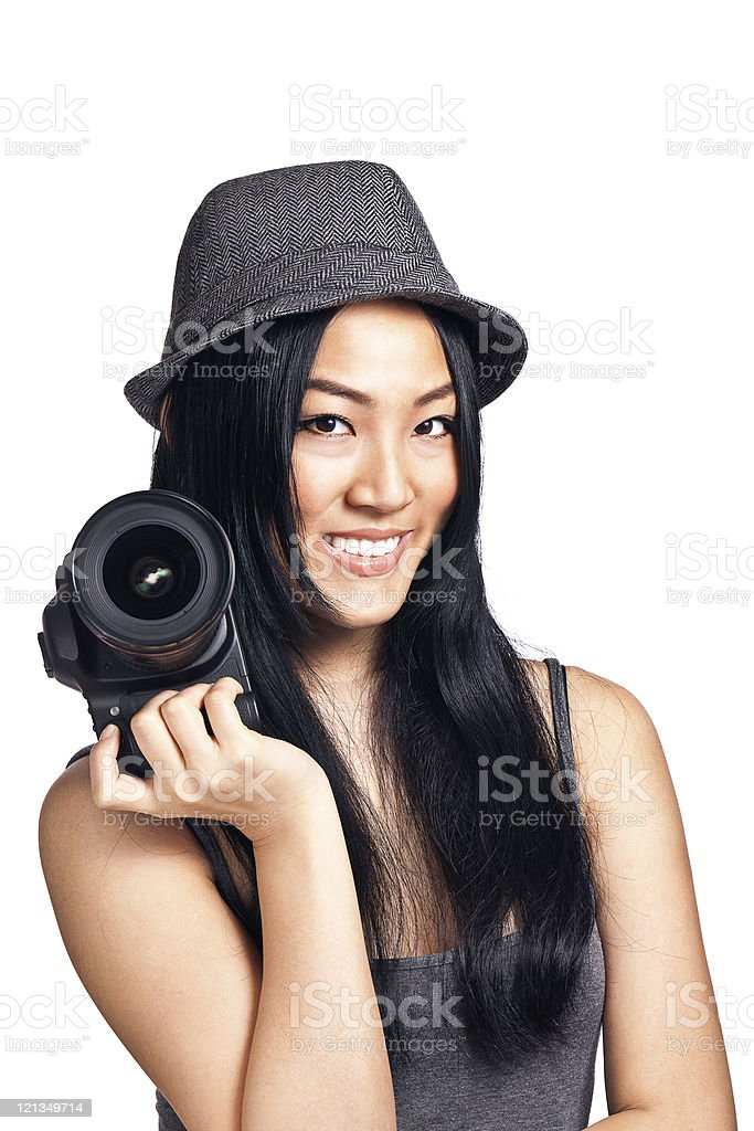 Young asian girl posing with a camera royalty-free stock photo