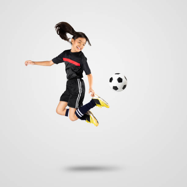 Young asian girl soccer player stock photo