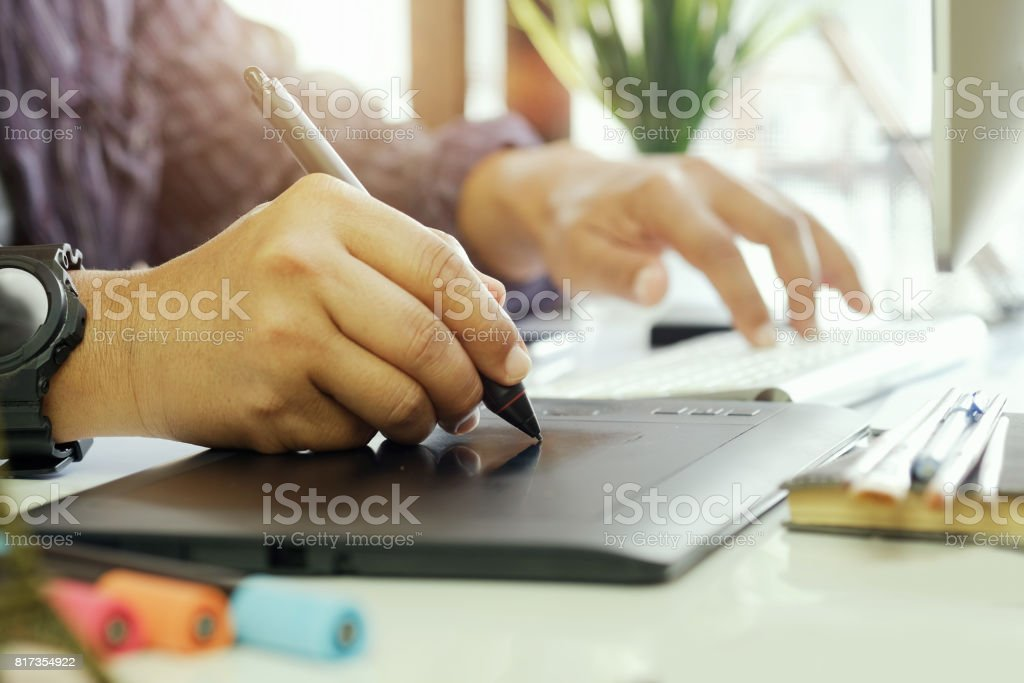 Young asian graphic designer working with  computer. stock photo
