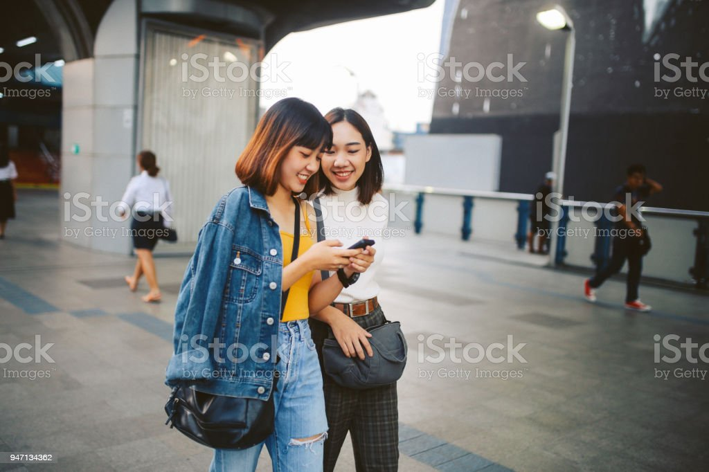 Young Asian in Bangkok, chatting over social media stock photo