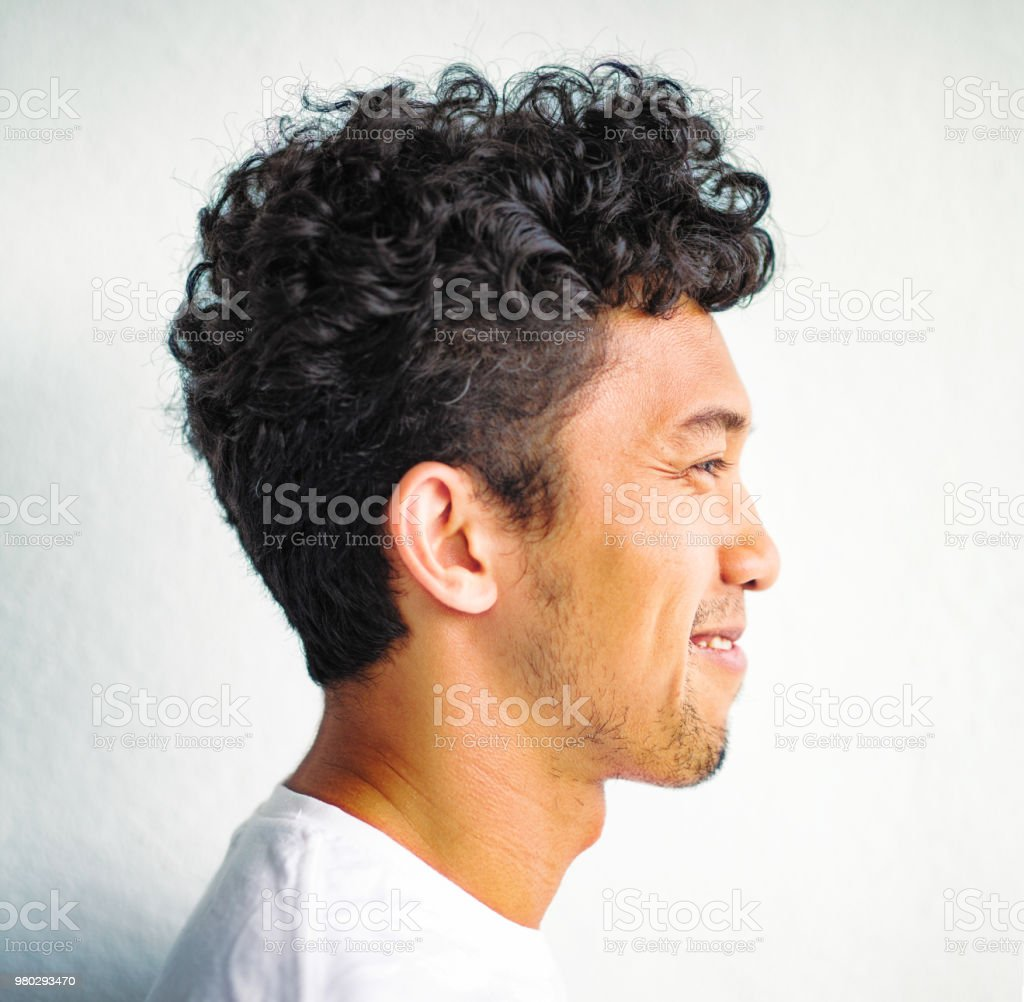 Young Asian Intellectual Man With Wild Curly Hair Profile