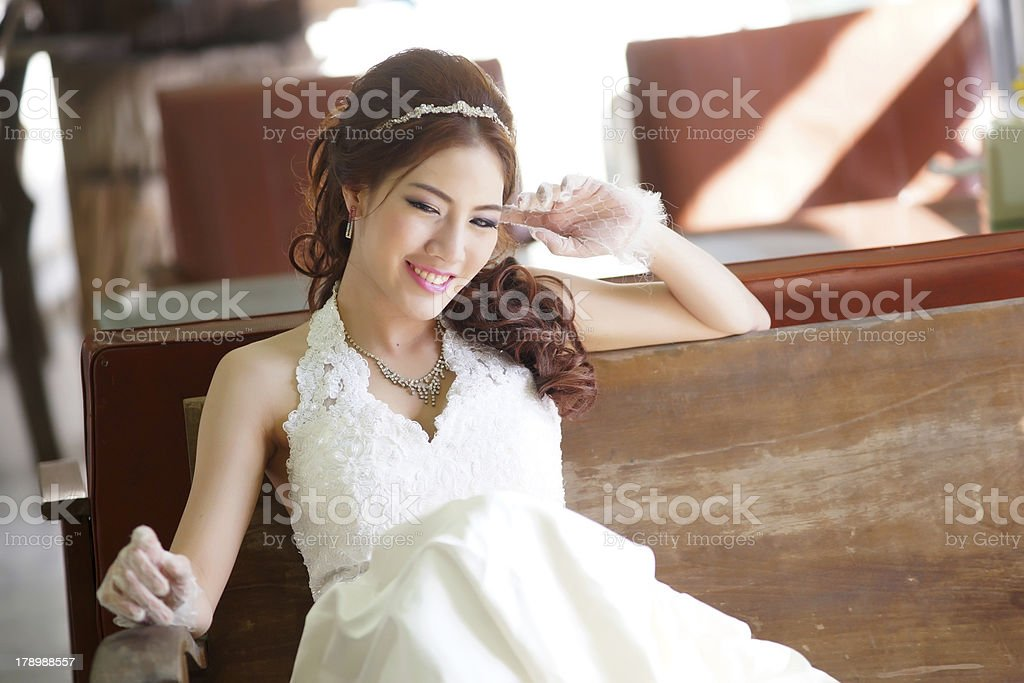 Young Asian lady in white bride dress royalty-free stock photo