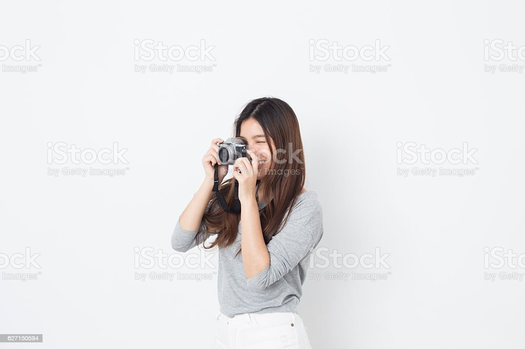 Young Asian lady photographer stock photo