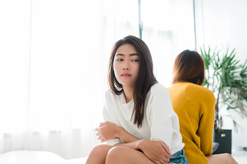 Young Asian Lesbian Couple Argue And Turn Their Back To Each Other In The Period Of Sad In The Bedroom Lgbt Couple Sulky To Another In The Bedroom With A Sad Mood Lgbt Lover Emotion Concept Stock Photo - Download Image Now