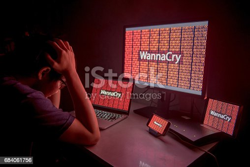 istock Young Asian male confused and headache by WannaCry ransomware attack 684061756