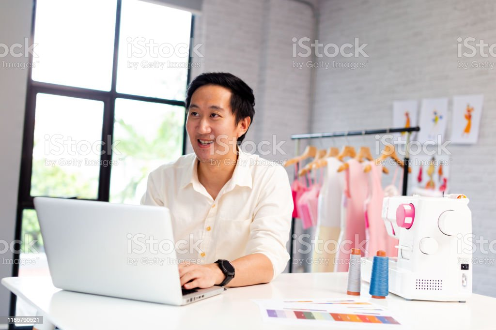 Young Asian Male Fashion Designer Using Laptop Stock Photo Download Image Now Istock