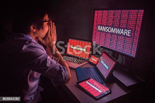 istock Young Asian male frustrated by ransomware cyber attack 803934282