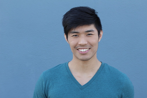 689644378 istock photo Young Asian male smiling and laughing 689644568