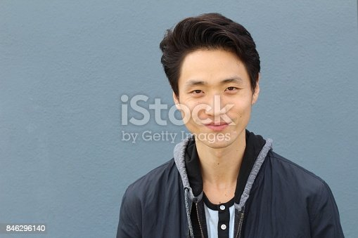 689644378istockphoto Young Asian male smiling and laughing 846296140