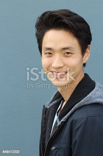 689644378istockphoto Young Asian male smiling and laughing 846412202