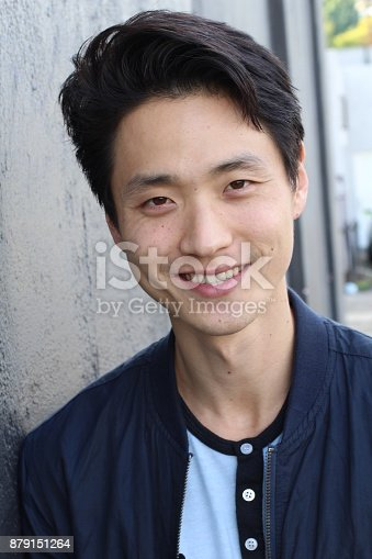 689644378istockphoto Young Asian male smiling and laughing 879151264