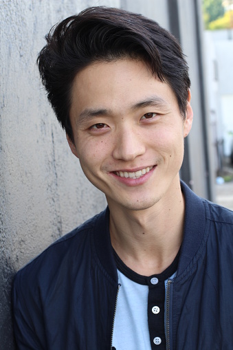 689644378 istock photo Young Asian male smiling and laughing 879151264